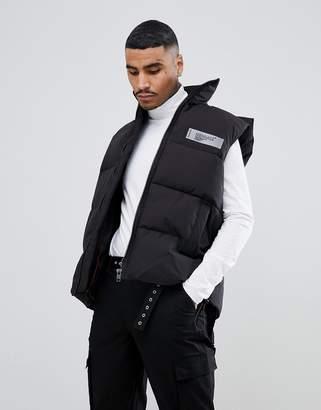 Mennace vest in black with back logo