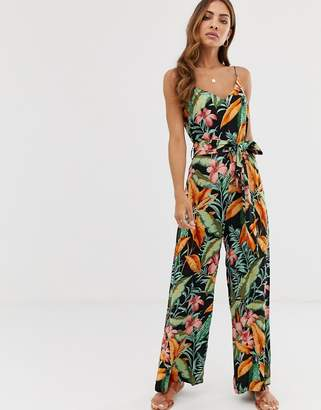 2d2236bb3a3c Warehouse cami jumpsuit with belt in tropical print