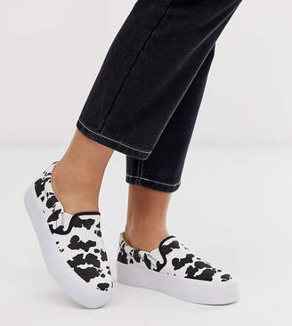 a13c5028c758 Asos Design DESIGN Wide Fit Deacon chunky slip on plimsolls in cow print
