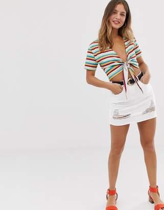 Parisian denim mini skirt with rips