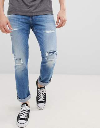 Tommy Jeans Scanton distressed slim fit jeans in light wash
