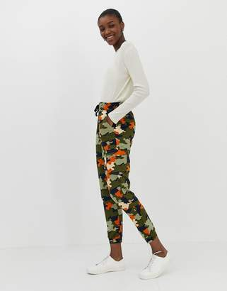 Asos Design DESIGN sweatpants in camo print with orange pop