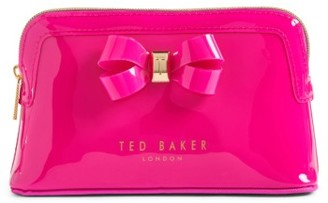 Ted Baker London Jamario Bow Cosmetics Case $49 thestylecure.com