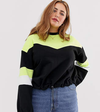 Asos DESIGN Curve sweatshirt in neon color block with drawstring hem