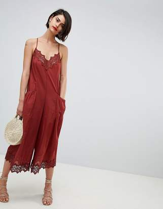 Asos Design DESIGN jumpsuit with lace trims and oversized pocket detail