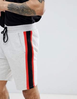 Asos Design DESIGN jersey skinny shorts with contrast side stripe panels