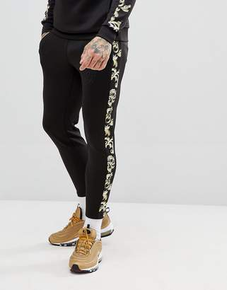 SikSilk cropped jogger in back with baroque side stripe