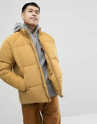 Asos DESIGN puffer jacket in mustard