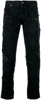 Diesel Black Gold slim jeans in over-distressed denim
