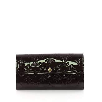 Louis Vuitton Sarah Red Patent leather Wallets