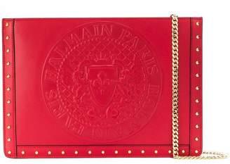 Balmain logo embellished clutch bag