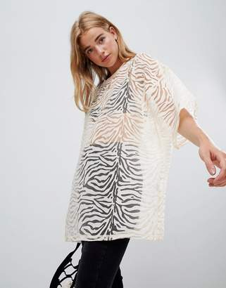 Glamorous relaxed top in zebra burnout