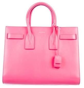 bceec88787e Saint Laurent Pink Open Top Handbags - ShopStyle