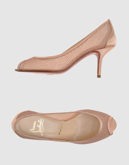 CHRISTIAN LOUBOUTIN Closed-toe slip-ons