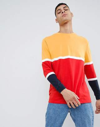 Asos DESIGN relaxed longline long sleeve t-shirt with bright color block in red