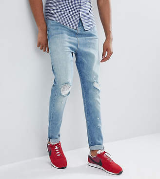 Asos DESIGN Tall Drop Crotch Jeans In Mid Wash Blue With Rips