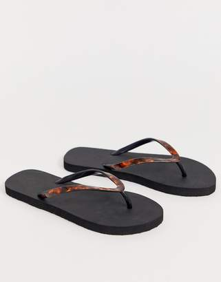 4f6042a82 Accessorize black flip flops with tortoise effect straps