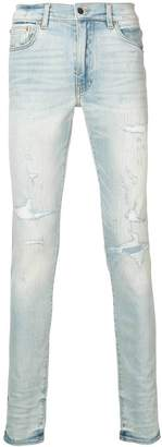 Amiri Light blue distressed skinny jeans