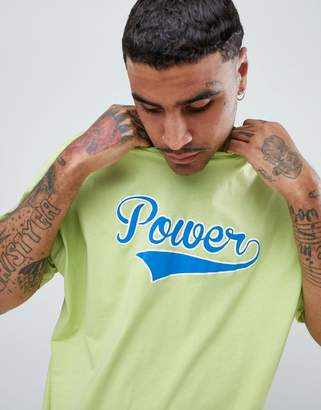 Asos DESIGN oversized t-shirt in washed neon with power text print