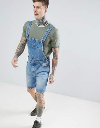 Asos DESIGN short overalls in mid wash blue