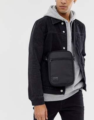 Asos DESIGN flight bag in black with patch