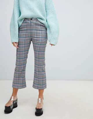 Lazy Oaf check kick flare pants with bow pocket detail