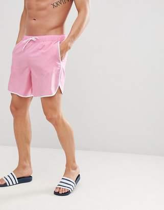 Asos DESIGN Runner Swim Shorts In Pink With White Binding Mid Length