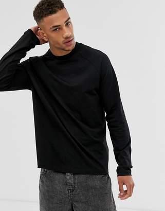 Asos Design DESIGN relaxed long sleeve raglan t-shirt with high neck in black