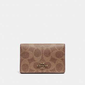 Coach Business Card Case In Signature Canvas