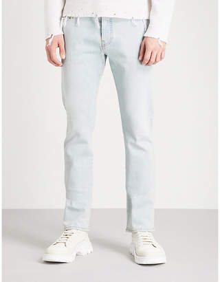 Valentino Rockstud-detail slim-fit tapered jeans