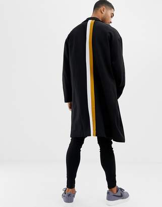 Asos DESIGN extreme oversized duster jacket in black with back stripes