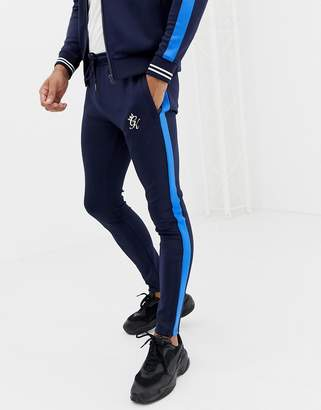 Gym King skinny sweatpants in navy with side stripe