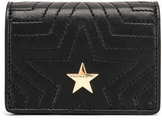Stella McCartney Small Flap Star Shoulder Bag in Black | FWRD