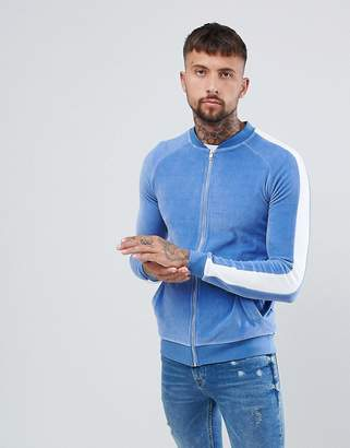 Asos DESIGN muscle bomber jacket in velour with side stripes
