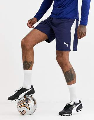 Puma Football shorts in navy with white side stripe exclusive to ASOS