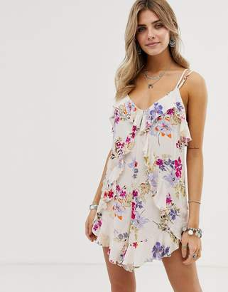 En Creme floral playsuit with ruffle front detail
