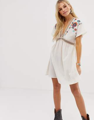 En Creme dress with embroidered kimono sleeves