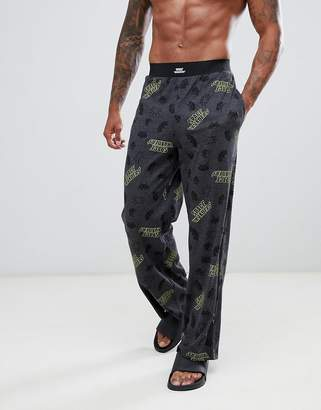 Asos DESIGN straight pyjama bottoms in Space Invaders print