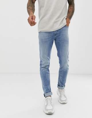 72650afd Diesel Tepphar slim carrot fit jeans in 081AL light wash