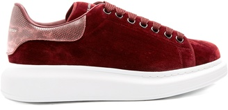 ALEXANDER MCQUEEN Raised-sole low-top velvet and leather trainers $575 thestylecure.com