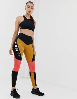 21e190cc2359a Nike Training High Waist Colourblock Leggings In Black And Gold
