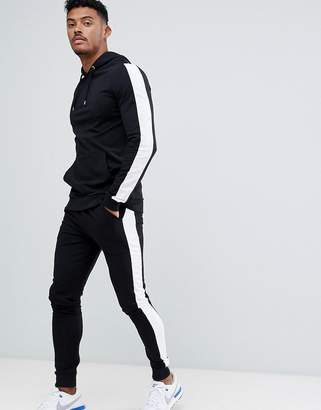 Asos DESIGN tracksuit muscle hoodie/ extreme super skinny joggers with white side stripe in black