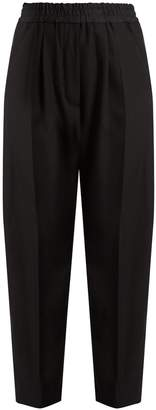 HAIDER ACKERMANN Berkeley high-rise wool trousers $619 thestylecure.com