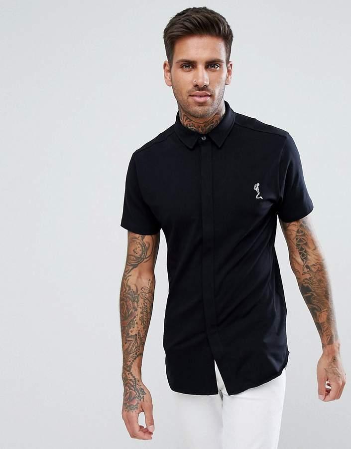 – Kurzärmliges Jersey-Hemd in Schwarz