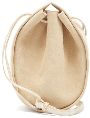 The Row Drawstring Round Suede Cross Body Bag - Womens - Ivory