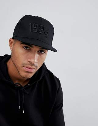 85c0fa1de5d Asos Design DESIGN snapback in black with 1994 embroidery