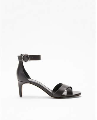 Express metallic low heel pumps