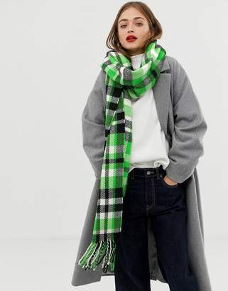 Asos DESIGN long green and black check scarf with tassels