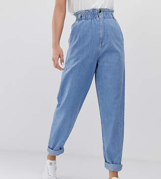Asos Tall DESIGN Tall Soft peg jeans in light vintage wash with elasticated cinch waist detail