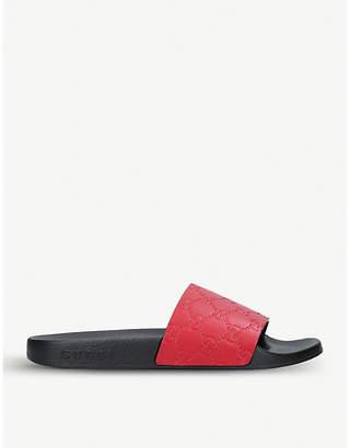 Gucci Pursuit rubber sliders